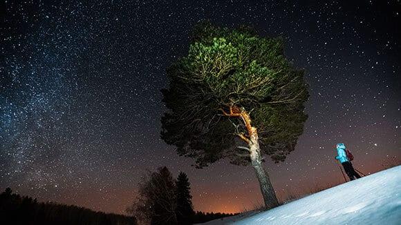 Night snowshoeing stars